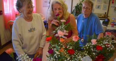special-delivery:-canon-signature-mortgage-and-touch-of-love-provide-carnations-to-local-care-centers,-assisted-living-homes-–-canon-city-daily-record